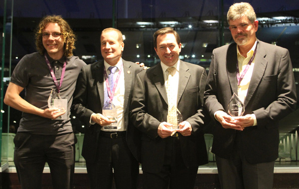 Caption: CRCSI Award winners – Ben Fitzpatrick, CRCSI PhD Student (Student Excellence Award); Professor David Lamb, CRCSI Science Director & University of New England Precision Agriculture Research Group Leader (Research Excellence Award); Mike Bradford, Landgate Chief Executive (Chair's Award); and Arthur Berrill, President of DMTI Spatial (Canada) (43pl Company Award).